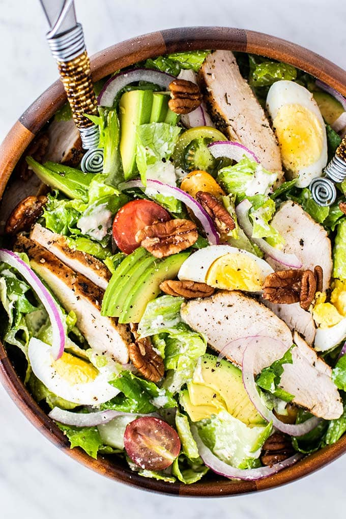 A close up view of a tossed Whole30 Chicken Caesar Salad.
