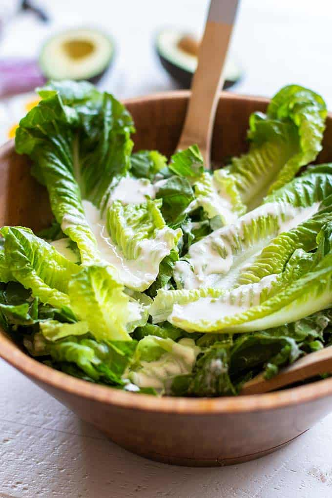Crunchy romaine lettuce coated with a creamy vegan caesar dressing.