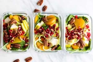 Colorful zoodle salads layered with golden beets, carrots, pomegranate and pecans.