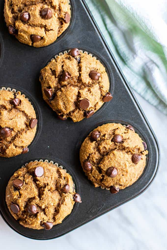 A muffin tin with freshly baked gluten free pumpkin muffins.