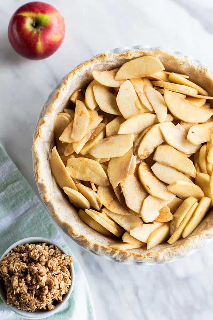 A partially baked pie crust filled with a lightly sweetened apple filling.