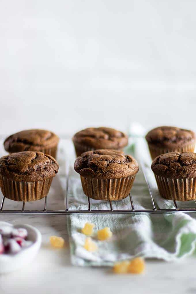 Warm gluten free gingerbread cupcakes on a cooling rack.