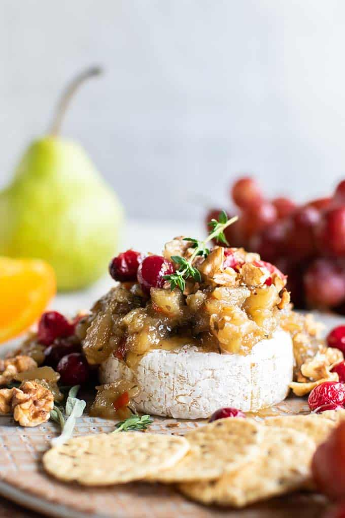 Brie topped with pear chutney ,roasted cranberries, and toasted walnuts.