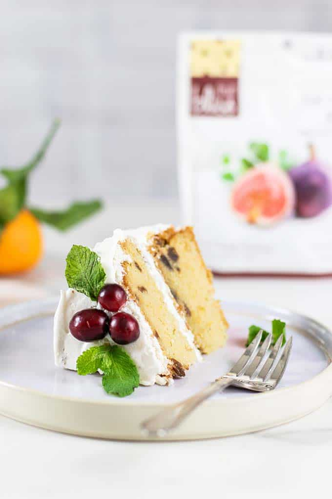 A slice of almond flour cake next to a bag of Fruit Bliss Turkish Figs.
