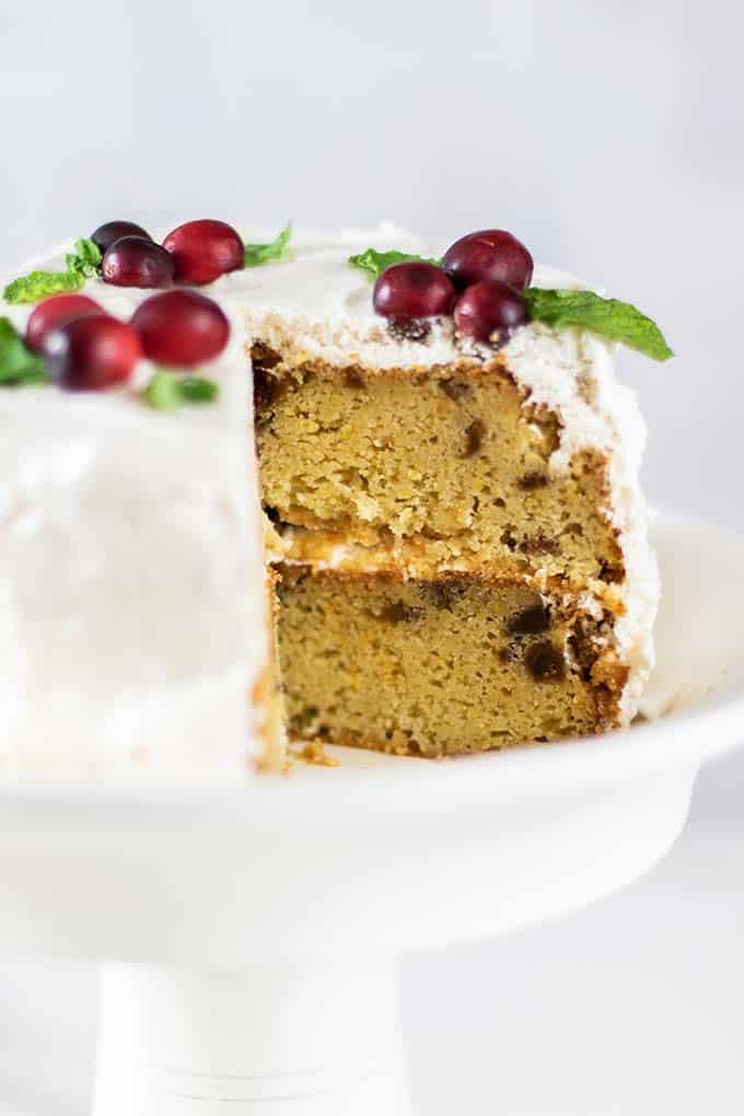 An almond flour cake shown on a white cake stand.