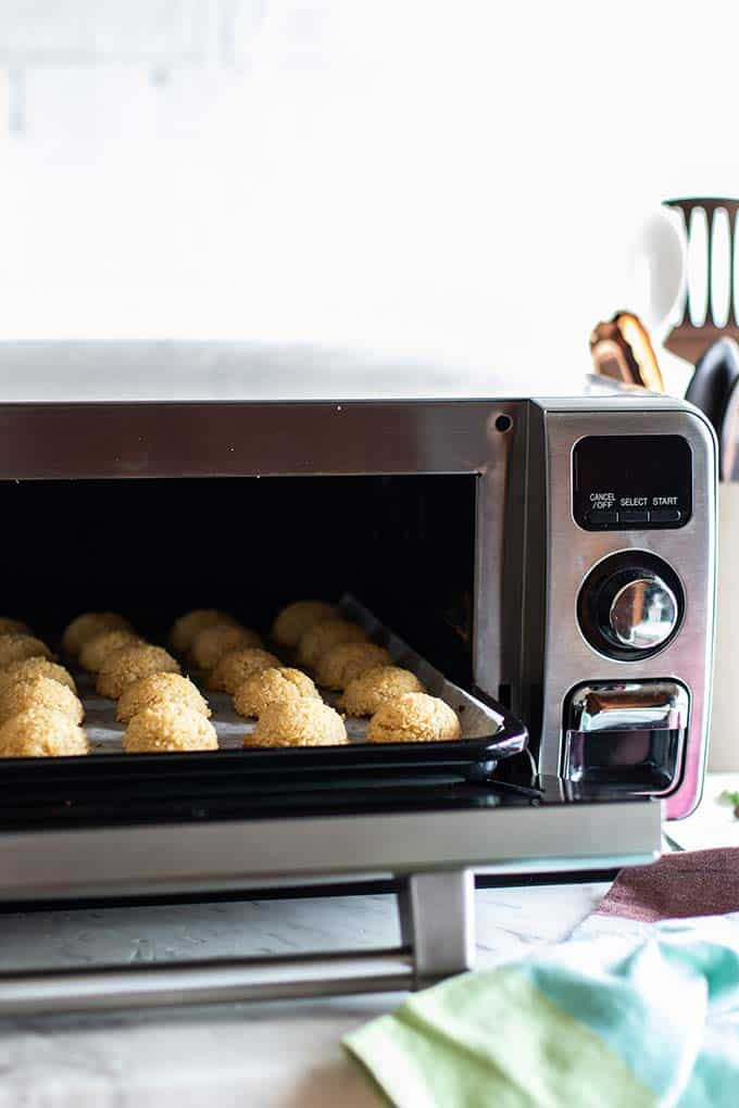 A tray of baked coconut macaroons coming out of the Sharp Superheated Steam Countertop Oven.