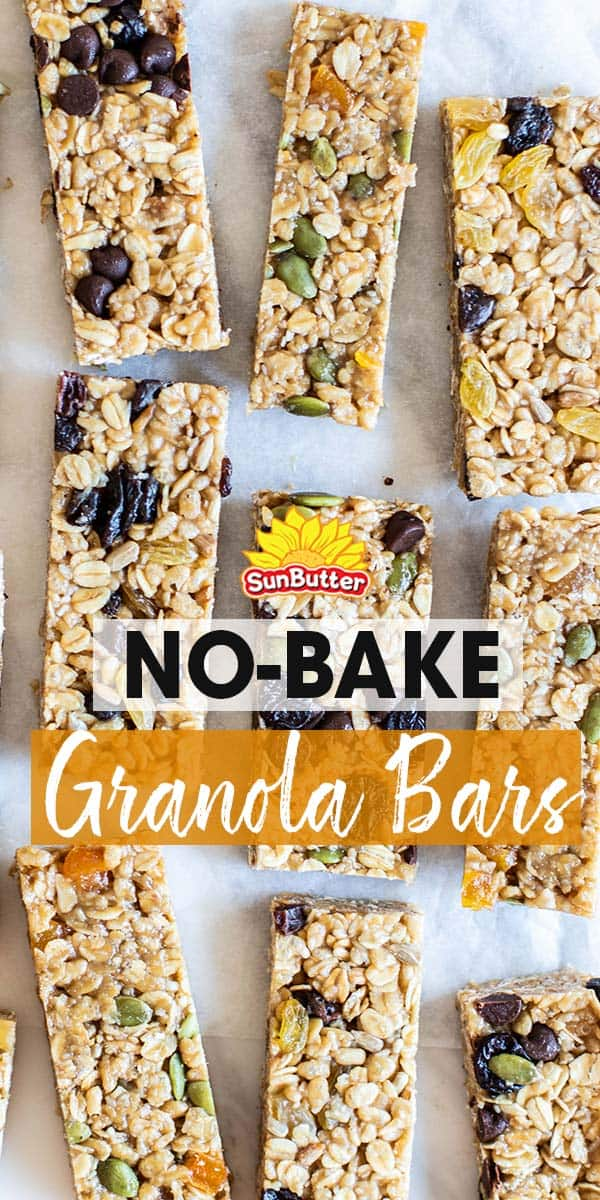 Lots of no bake granola bars on a piece of parchment paper.