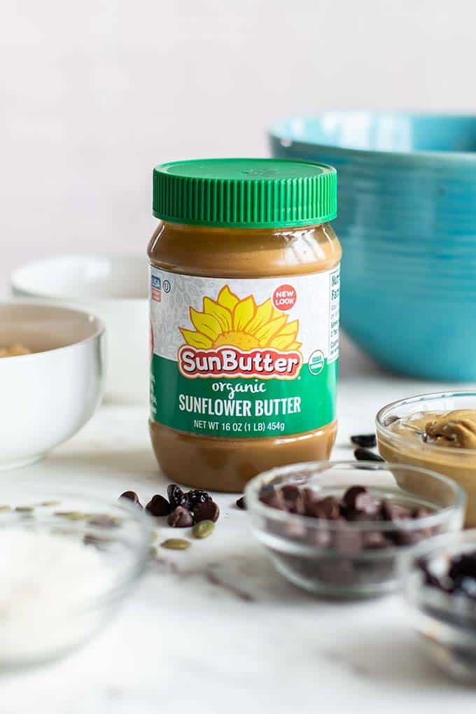 A jar of SunButter with mix in options for no bake granola bars.