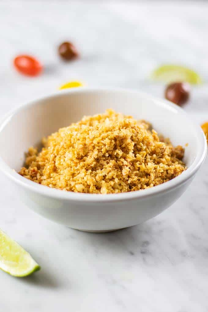 A bowl of cooked and seasoned cauliflower rice.