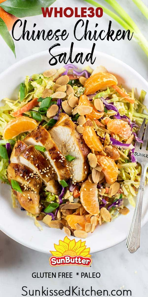 A close up of a Whole30 Chinese Chicken salad with cabbage, oranges, carrots, and almonds.