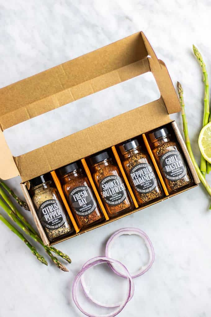A box of 5 difference FreshJax spice bottles.