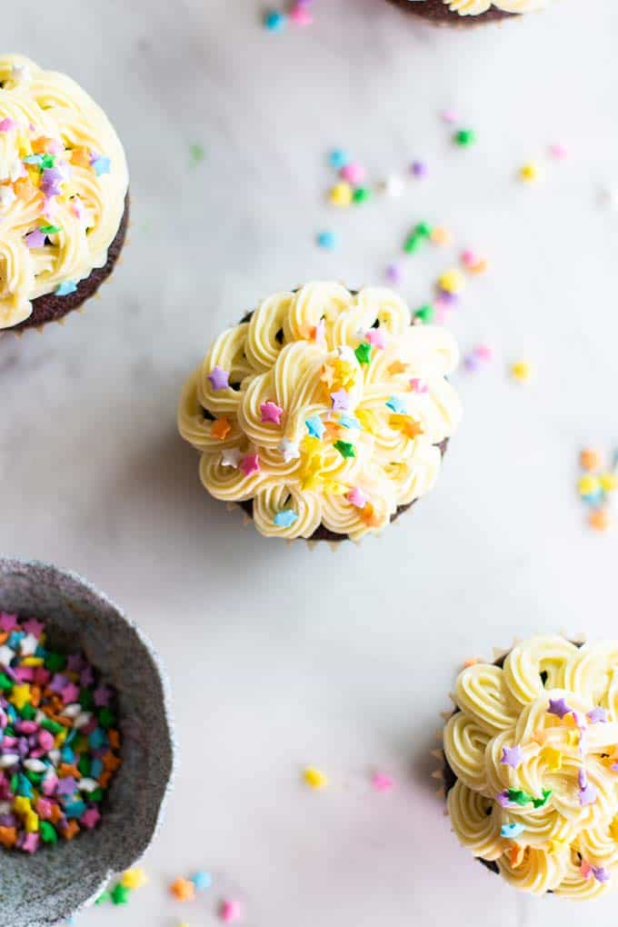 Cupcakes frosted with healthy frosting and sprinkled with pastel stars.