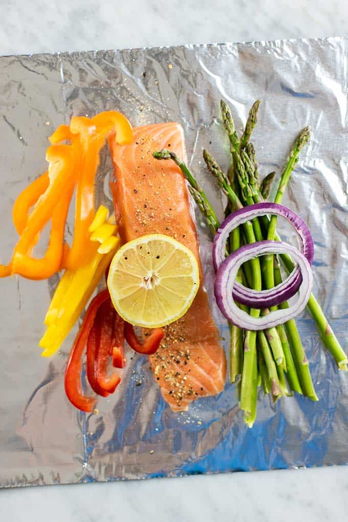 How to wrap salmon and veggies in foil packets.
