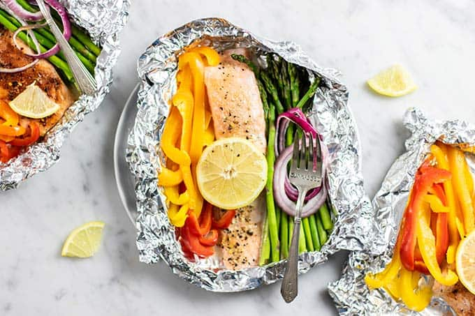 3 foil packets with baked salmon and veggies.