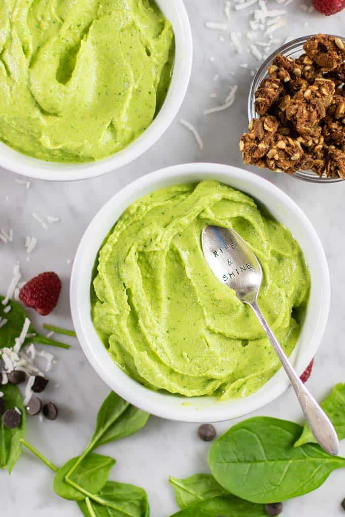 Thick green smoothie in bowls.