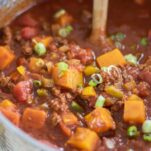 A large pot filled with a whole30 beef and butternut chili.