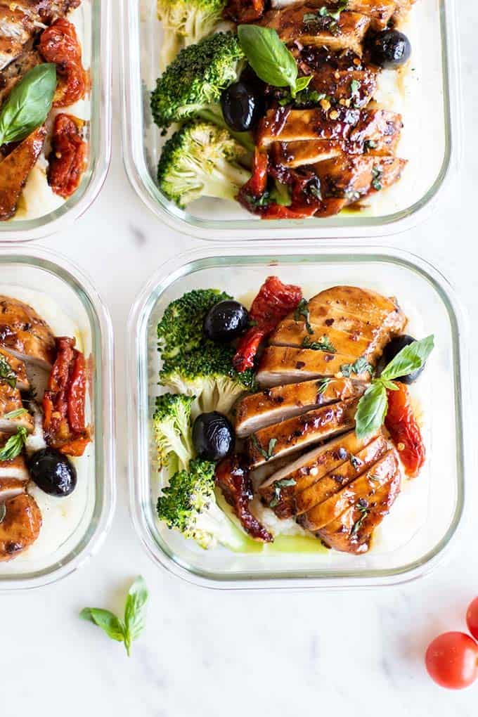 Balsamic chicken packed in meal prep containers.