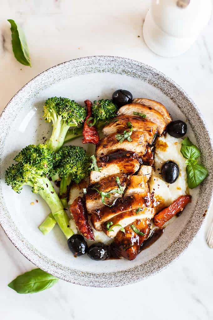 Balsamic chicken served over cauliflower mash with broccoli.
