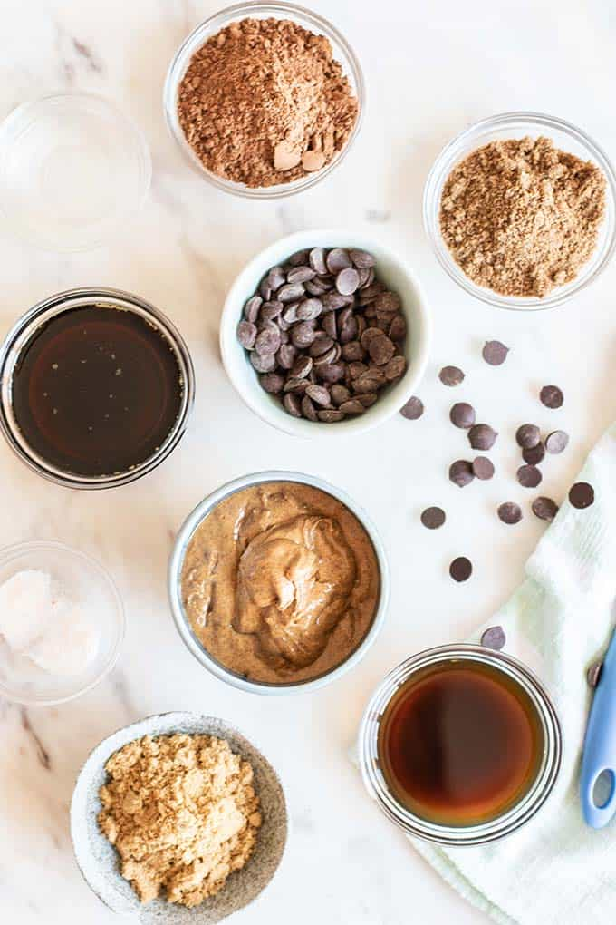 The ingredients for vegan brownies arranged on a countertop.