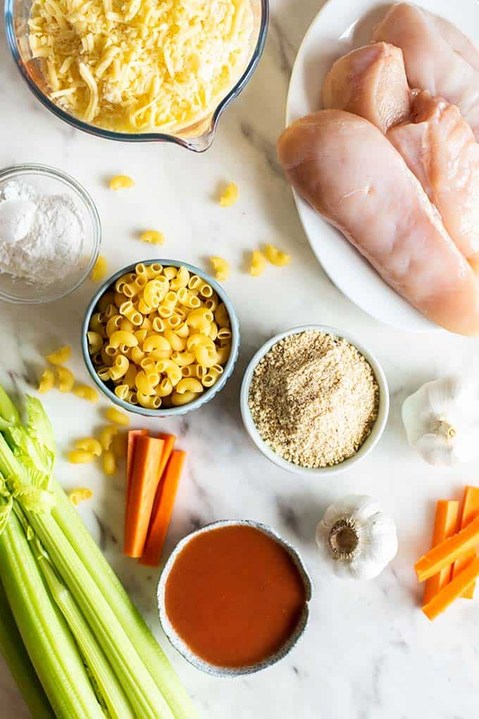 The ingredients for buffalo chicken mac and cheese laid out ready to be prepared.