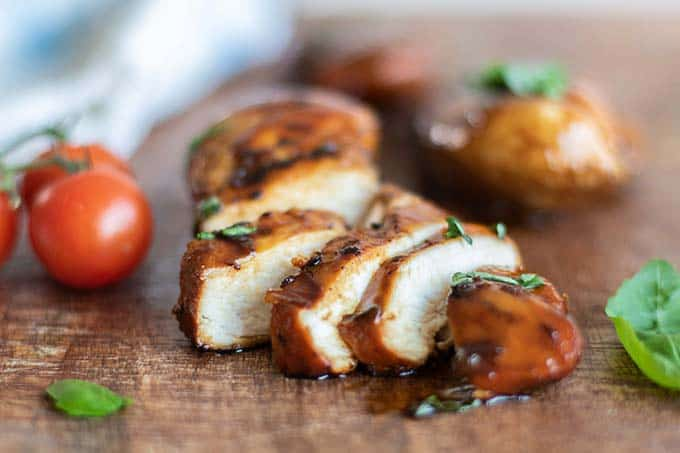 A balsamic chicken breast sliced to show the tender texture.