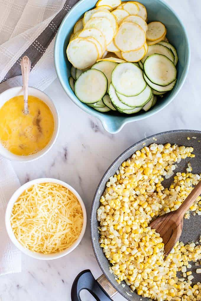 The ingredients prepared ready to put together the sweet corn zucchini pie recipe.