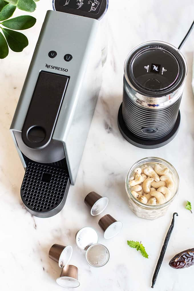 A Nespresso Machine and an Aeroccino machine, used to make this frothy cashew milk iced coffee.