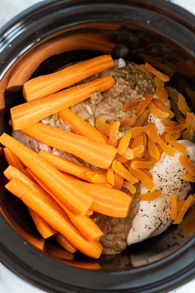 A crockpot filled with all the ingredients ready to be cooked.