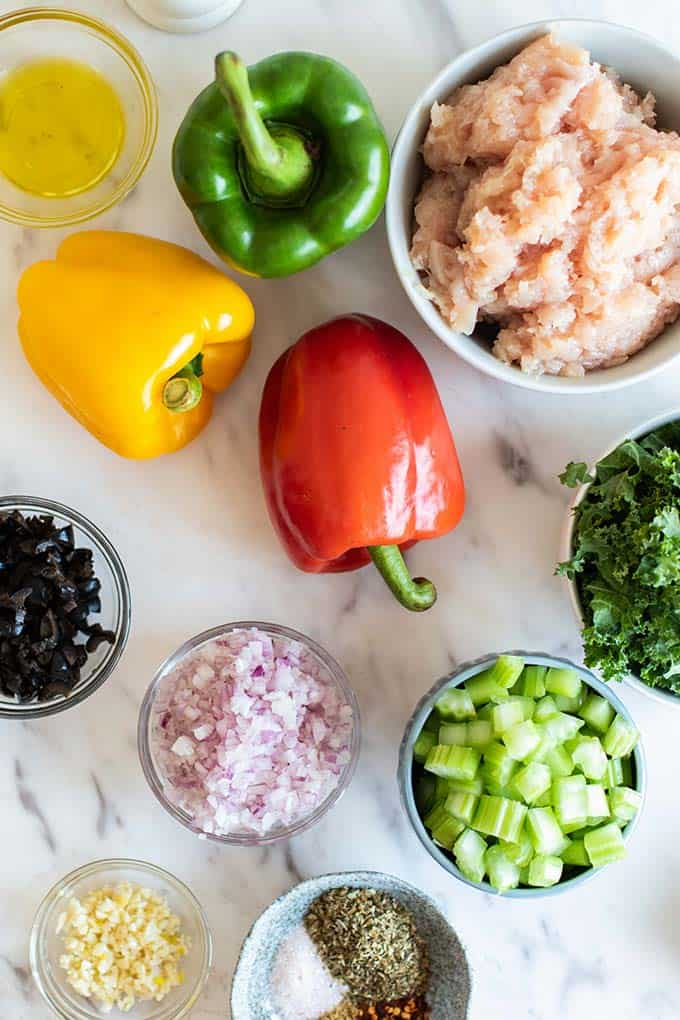 The ingredients for stuffed peppers arranged on a counter.