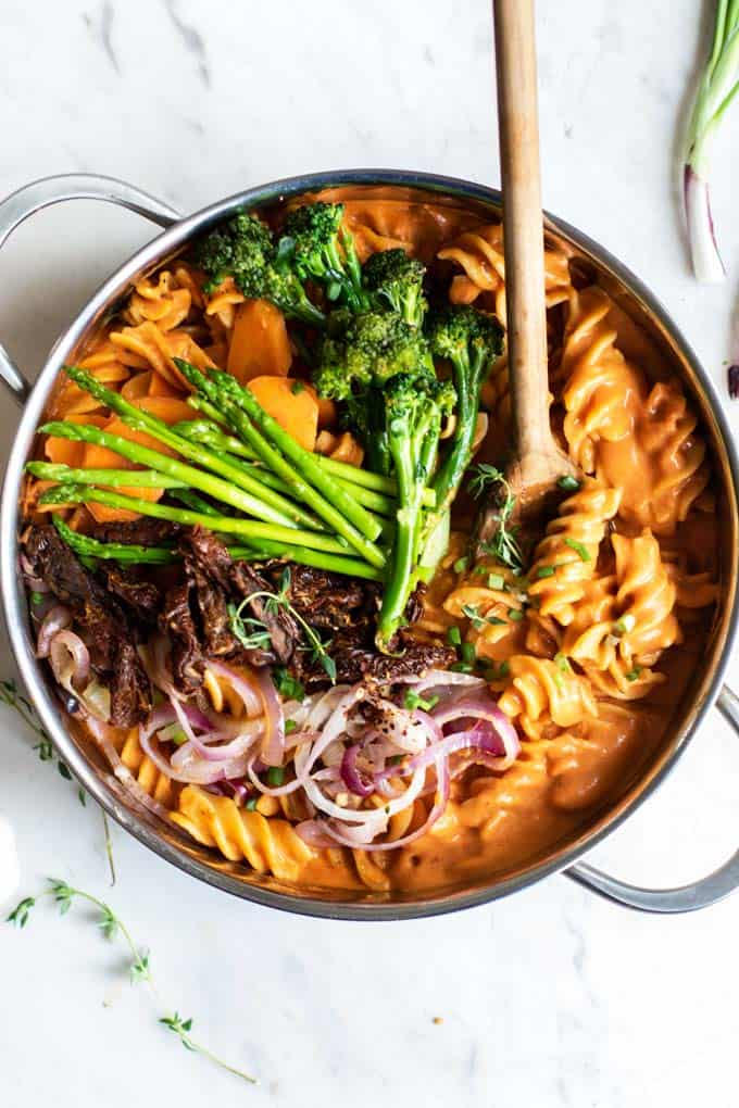 A creamy tomato one pot pasta made with sundried tomatoes and asparagus.
