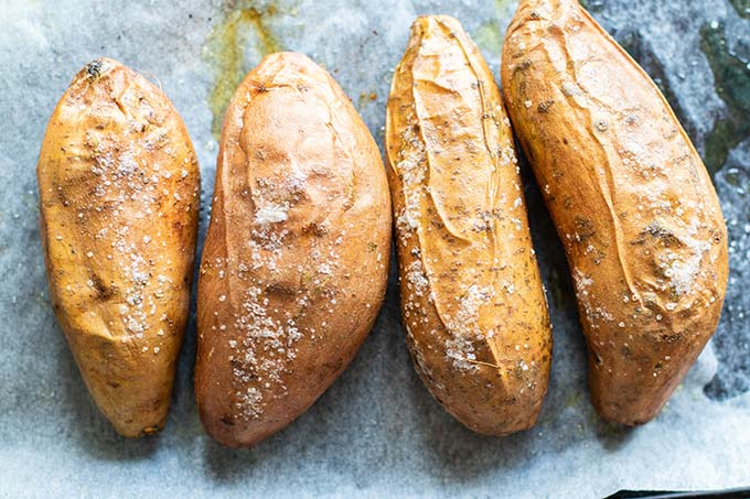 Baked wrinkly sweet potatoes covered in a light crunchy sprinkling of salt,.