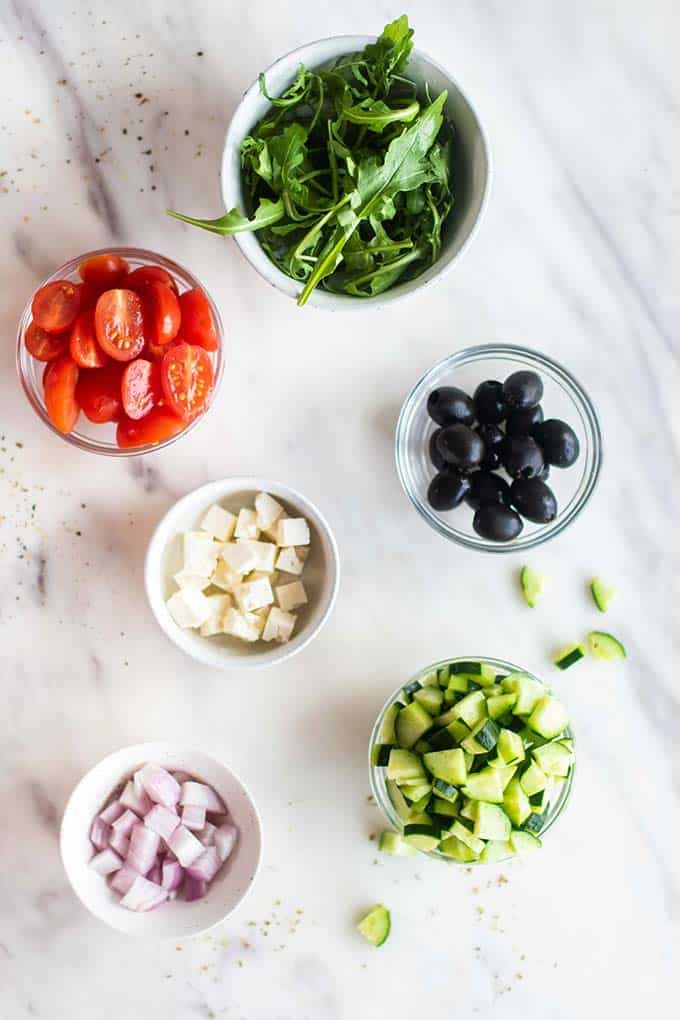 The ingredients for a Greek salad filling.