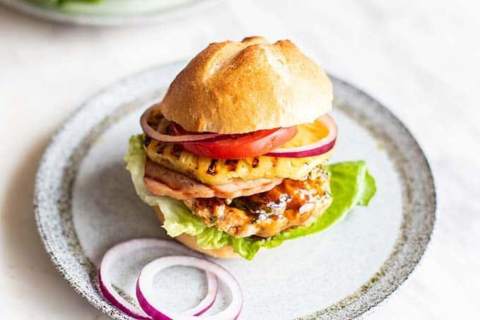 A Hawaiian Chicken Burger on a gluten free bun.