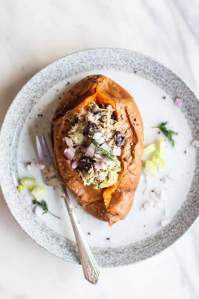 A baked sweet potato stuffed with tart cherry tuna salad.