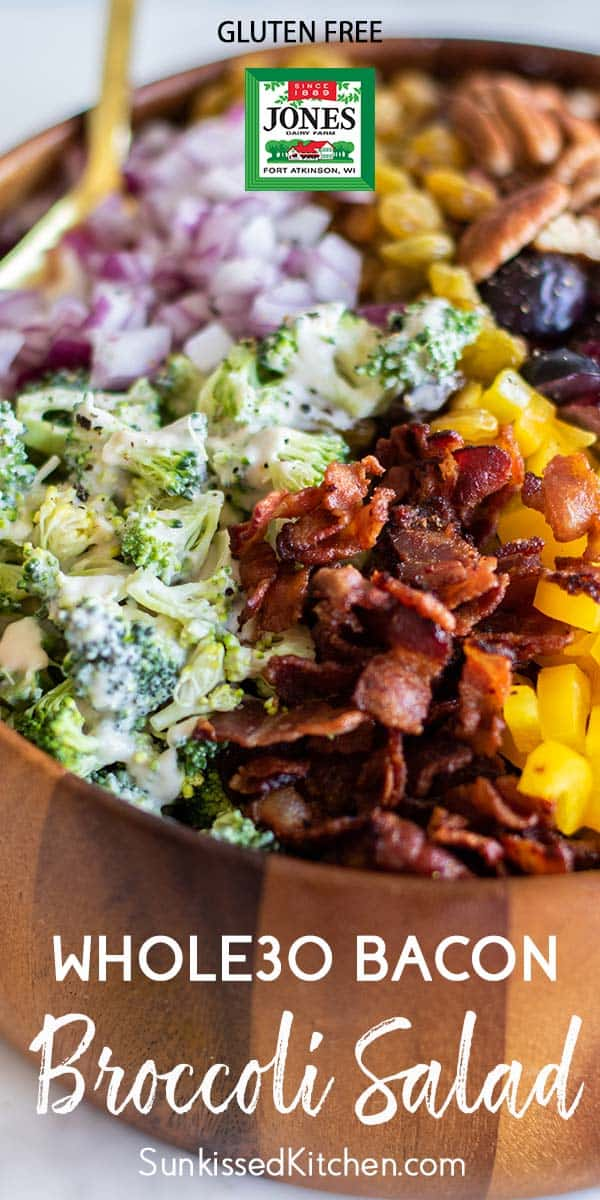 A close up shot of a crunchy broccoli bacon salad loaded with toppings.