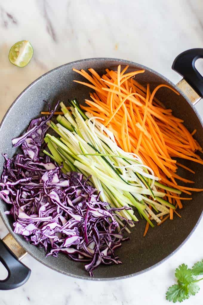 A pan showing julienned vegetables ready to add to the pasta.