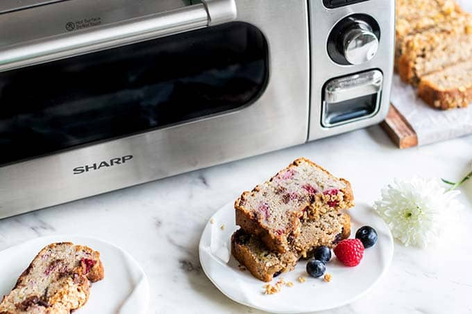 Sharp Superheated Steam Countertop Oven with slices of banana bread shown in front.