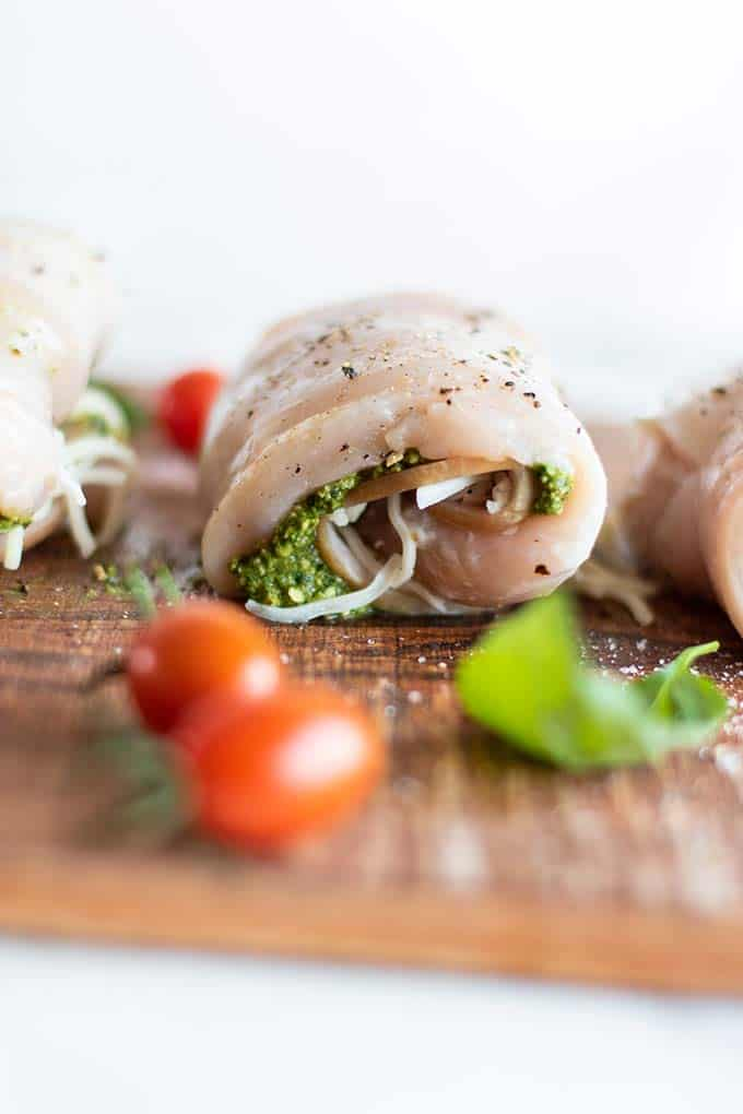 A chicken breast stuffed with pesto, canadian bacon and cheese.