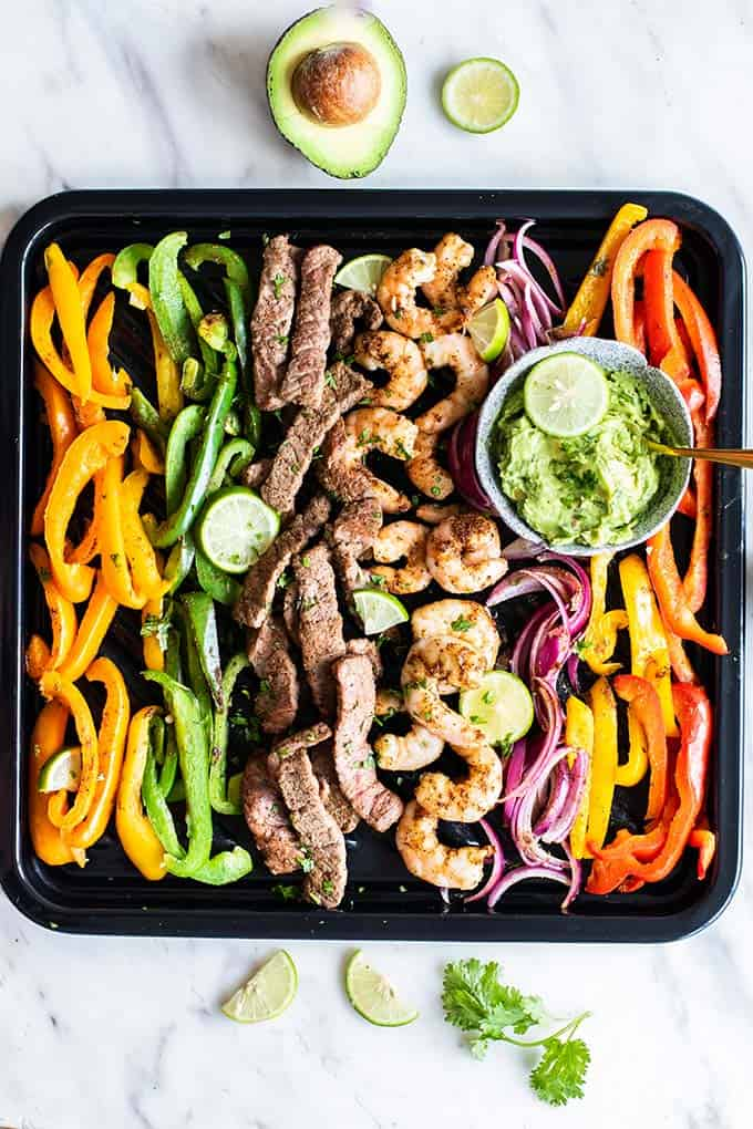 A top down view of beef and shrimp fajitas.