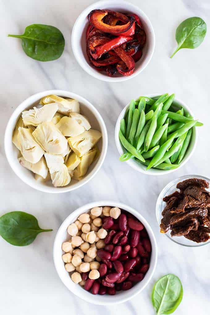 The ingredients for a mediterranean 3 bean salad.