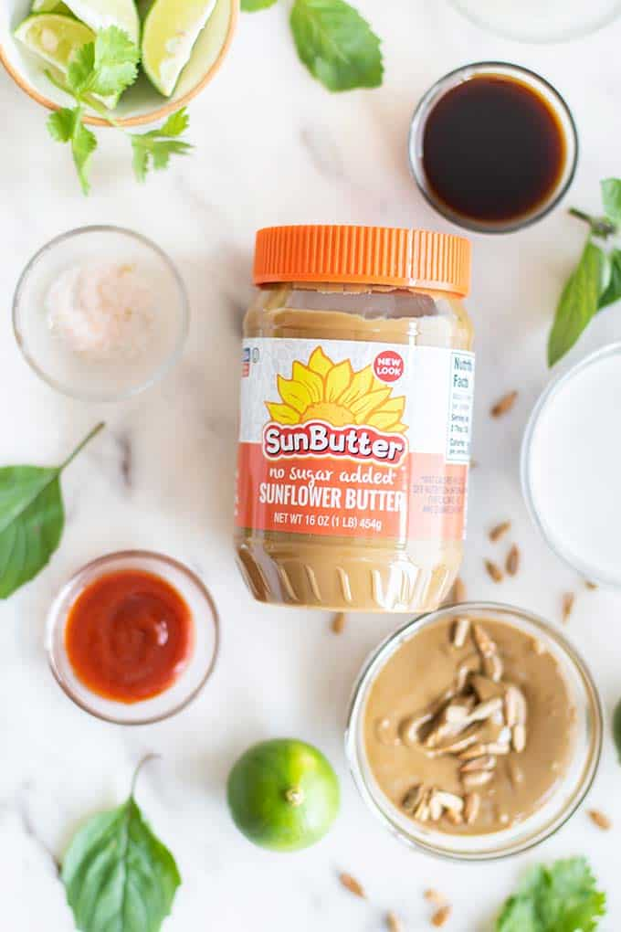 A jar of SunButter surrounded by the ingredients for the spicy dipping sauce.