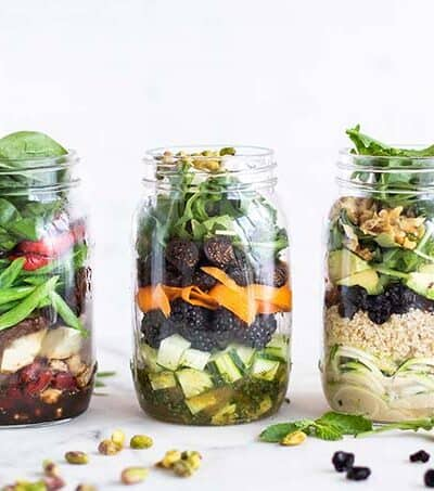 3 Mason jar salads showing how to pack the layers.