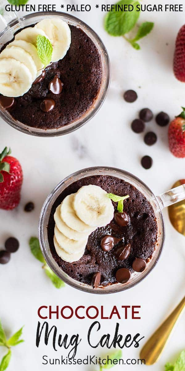 A close up showing a baked chocolate mug cake sprinkled with chocolate chips and sliced bananas.