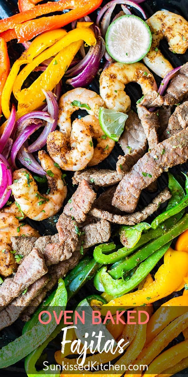 A close up view of baked shrimp, steak, and fajita veggies.