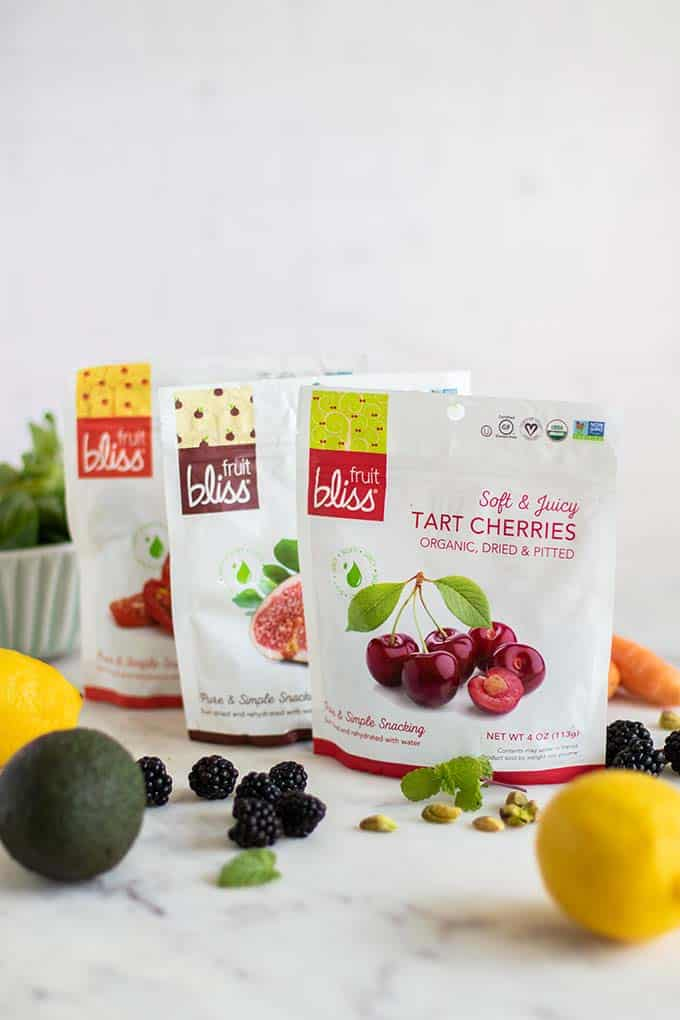 Three fruit bliss bags with figs, tart cherries, and tomato halves.