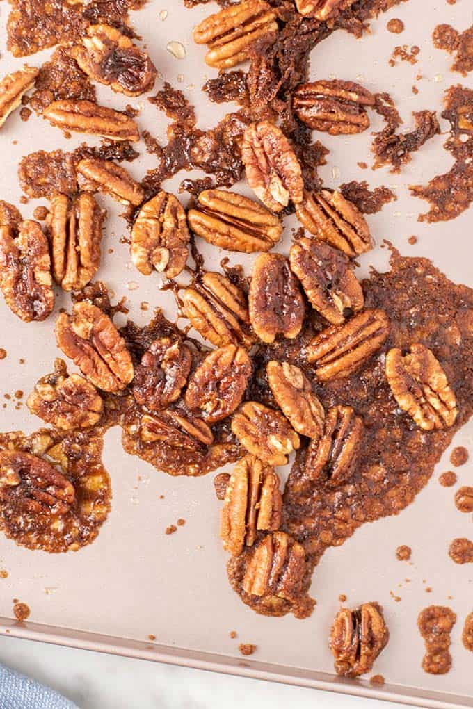 A baking tray with caramelized pecans.