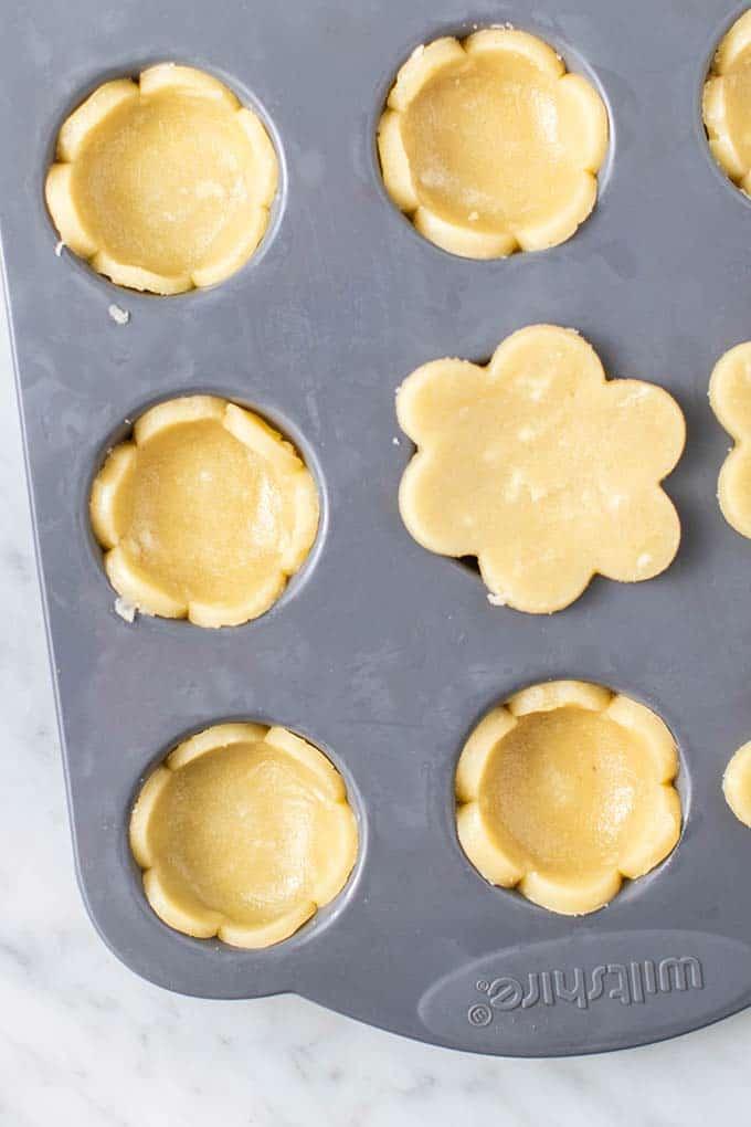 Pie crust dough cut into flower shapes.