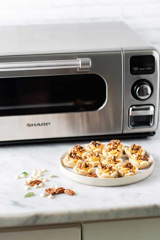 Sharp Superheated Steam Countertop Oven with a plate of mini pumpkin pies.