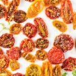 Sun dried tomatoes made in the oven in a variety of colors.