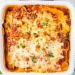 A butternut squash lasagna baked until the cheese is browning and bubbling on top.